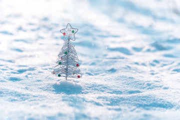 Christmas tree decoration on real snow outdoors. Winter holidays concept. Shallow depth of field.