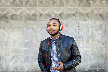 Young man with headphones and smartphone