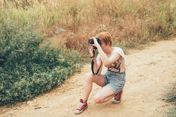 redhead photographer female in countryside