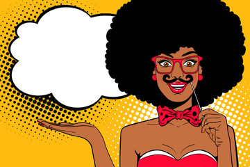 Pop art face. Young sexy afro american woman with bow tie holding mustache mask in her hand smiling and empty speech bubble. Vector illustration in retro comic style. Holiday party invitation poster.