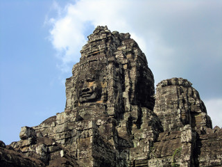 Bayon temple with carved stone faces in Siem Reap Cambodia jungle