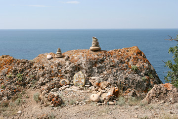 The sanctuary of unknown Hindu god on the rocky sea shore. This photo was taken on the Meganom cape in Crimea.