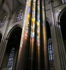 Colored flecks of sunlight on the columns