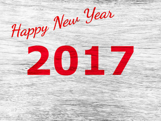 Text happy new year 2017 on wooden background.