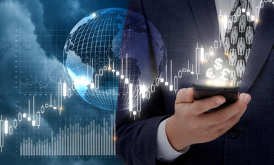 Businessman works at the stock exchange via a mobile device.