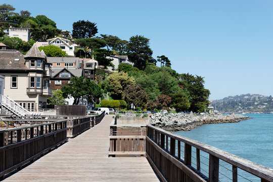 Looking back towards downtown Sausalito from a wooden boardwalk
