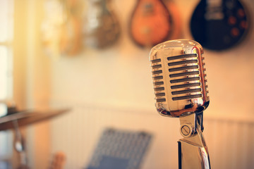 Vintage silver microphone image with warm filter