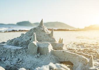 Sand castle on the beach after sea storm in sardinian beach