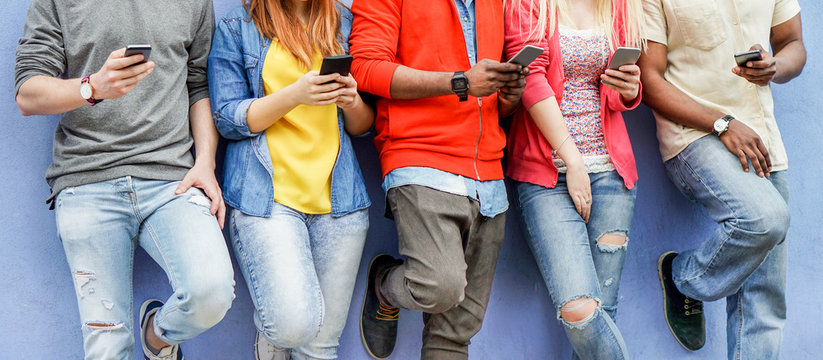 Group of multiracial students watching smart mobile phones