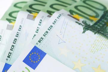 100 Euro banknotes isolated on white background