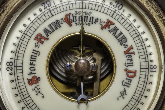 Climate Change symbolised by a vintage weather barometer forecasting change.