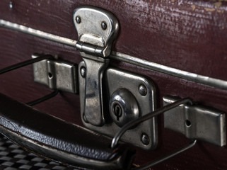 close-up fragment of locks and fasteners on the vintage leather