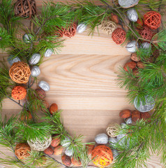 Christmas wreath on wooden background in a frame