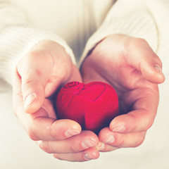 Heart,Gift in the Hands of Men. Offer Love To A Woman.Holiday Valentine's Day.Wedding.toned image..selective focus.
