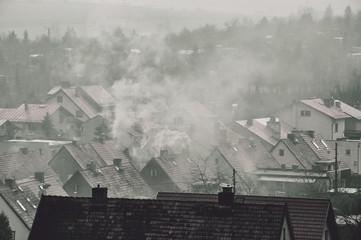 Fototapeta Dymy nad budynkami