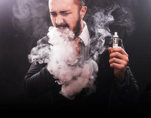 young man suffocating in vape smoke