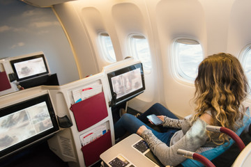 Passenger in business class of airplane