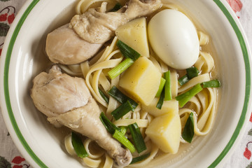 caldo de gallina, the classic Peruvian chicken noodle soup