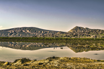 Landscape wonderful of rocky hills reflected in the clean and calm  lake with  peaceful sky