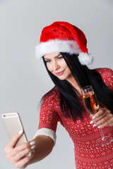 Brunette in Christmas makes selfie