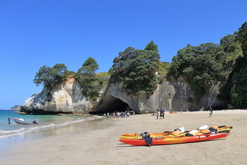 canoes on the beach of cathedral cove