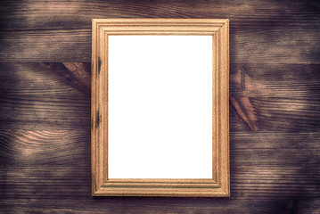 Empty wooden frame on a wood textured surface, vintage toning