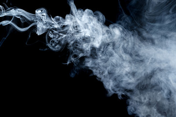 Abstract smoke Weipa. Personal vaporizers fragrant steam. The concept of alternative non-nicotine smoking. Blue smoke on a black background. E-cigarette. Evaporator. Taking Close-up. Vaping.
