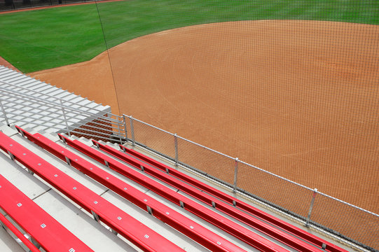rows of seats in college stadium and baseball field
