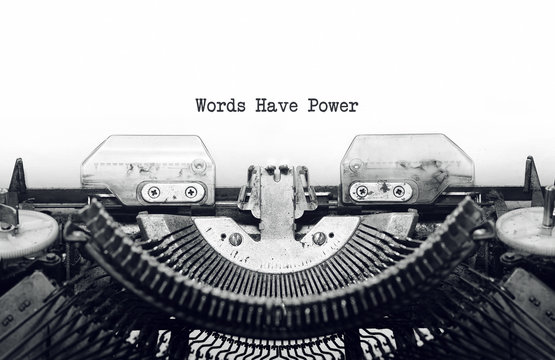 Vintage typewriter on white background with text Words Have Powe
