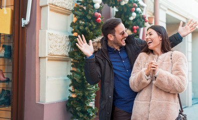 Young couple in shopping looking for Christmas and New Year's gi