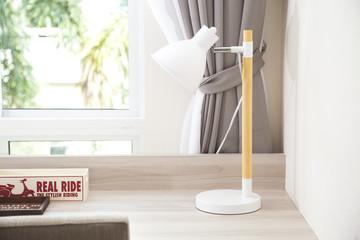 modern table lamp on table in teenage bedroom