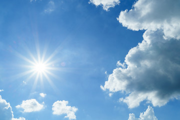 Sun flare with cloudy blue sky background