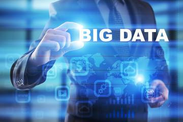 Businessman selecting big data on virtual screen.