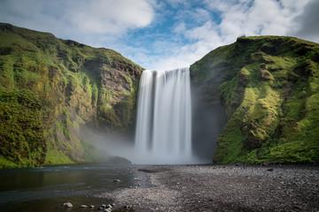 Recess Fitting Waterfalls Skogafoss, an Icelandic waterfall with a long exposure