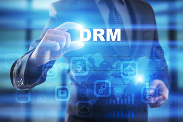 Businessman selecting drm on virtual screen.