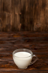 Cup of milk on rustic wooden table