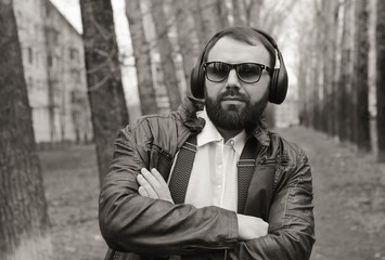 monochrome beard man listen music in park