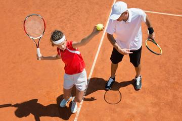Practicing tennis service
