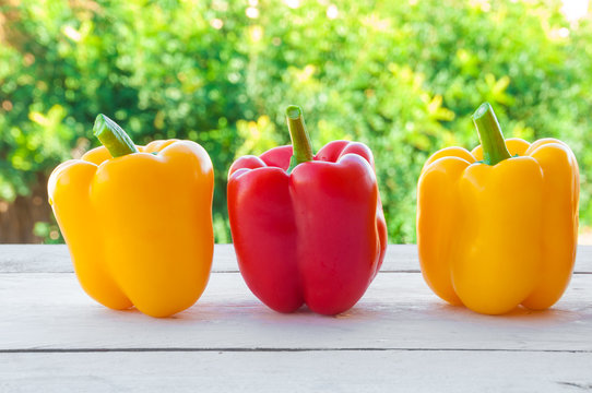 Fresh red and yellow bell peppers outdoors