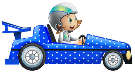Little girl in polka dot racing car