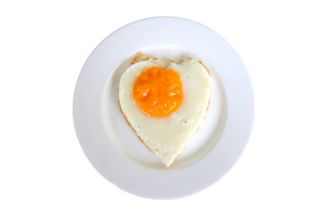 Isolated fried eggs in ideal heart on the white plate on white background