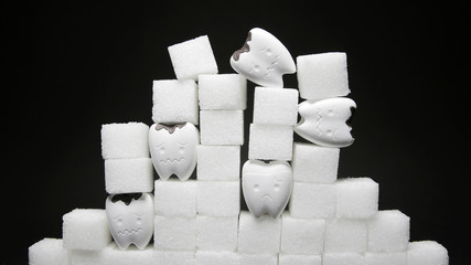 Heap of a lot of cubes sugar and decayed tooth in bad and sad emotion 3