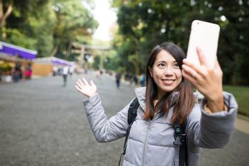 Woman take self photo at Japanese temple
