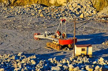 Big heavy excavator in granite quarry