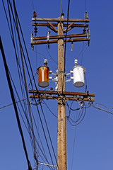 Wood high tension pole with hot transformer