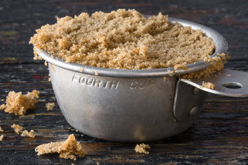 Brown sugar packed in a vintage measuring cup
