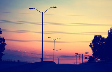 Street lights and power lines with a Colorful Sky