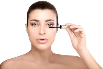 Beauty model young woman applying mascara