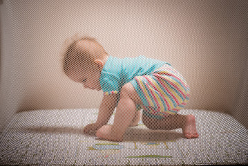 Cute baby playing in an arena at home