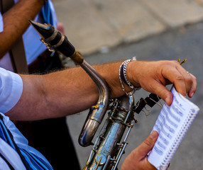musician plays the clarinet during a religious procession